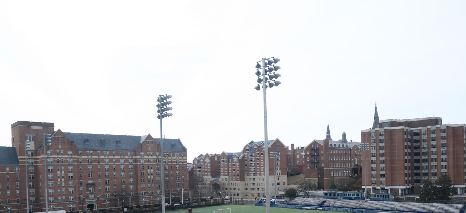 Lights loom over Cooper Field on a sunny day